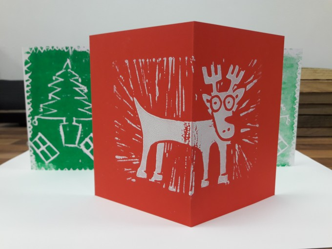 White reindeer on red background